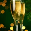 Stock Photo: Champagne glasses and gift
