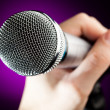 Hand holding the microphone — Stock Photo