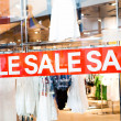 Sale title on shop window — Stock Photo #10239080