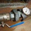Stok fotoğraf: Thermometer on the pipe and tap