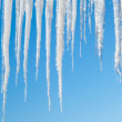 Icicles on blue — Stock Photo