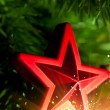 Christmas-tree decoration - red star with glare sparkles — Stock Photo