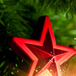 Christmas-tree decoration - red star with glare sparkles — Stock Photo #10239424