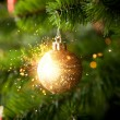 Christmas-tree decoration with shiny sparkles — Stock Photo