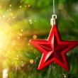 Christmas-tree decoration - red star with glare sparkles — Stock Photo #10239445