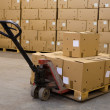 Boxes on hand pallet truck — Stock Photo #10239633