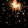 Yellow sparkler with fire particles — Stock Photo