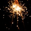 Yellow sparkler with fire particles — Stock Photo #10239647