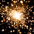 Yellow sparkler with fire particles — Stock Photo #10239659