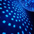 Disco ball with blue illumination — Stock Photo
