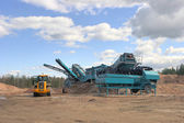 Making of crushed stone at stone quarry — Stock Photo