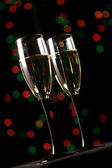 Champagne glasses on festive background — Stock Photo