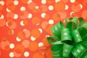 Green bow on festive background — Stock Photo
