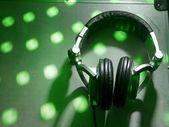 Dj headphones on party background — Stock Photo