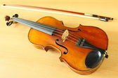 Antique violin with a fiddlestick — Stock Photo