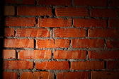 Aged brick wall illuminated with spotlight — Stock fotografie