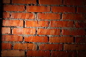 Aged brick wall illuminated with spotlight — Foto Stock