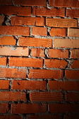 Aged brick wall illuminated with spotlight — Zdjęcie stockowe