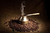 Old coffee pot with smoke — Stock Photo