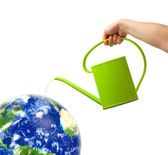Watering can and globe — Stock Photo