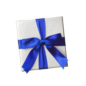 Gift with blue bow — Stock Photo