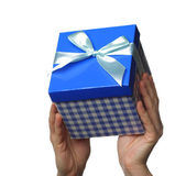 Hands holding a gift — Stock Photo