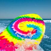 Surf board with wave splash — Stock Photo