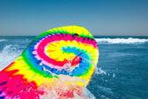 Surf board in the blue sea — Stock Photo