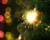 Christmas ornament with fireworks — Stock Photo