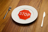 Diet concept - stop sign on the plate — Stock Photo