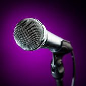 Microphone against the purple background — Stock Photo