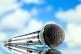 Microphone on blue — Stock Photo