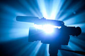 Video camera silhouette with blue rays — Stock fotografie
