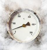 Thermometer and smoke — Stock Photo