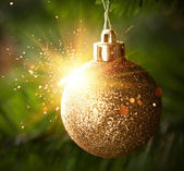 Christmas ornament ball with shiny sparks — Stock Photo