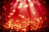 Shiny hearts background — Stock Photo