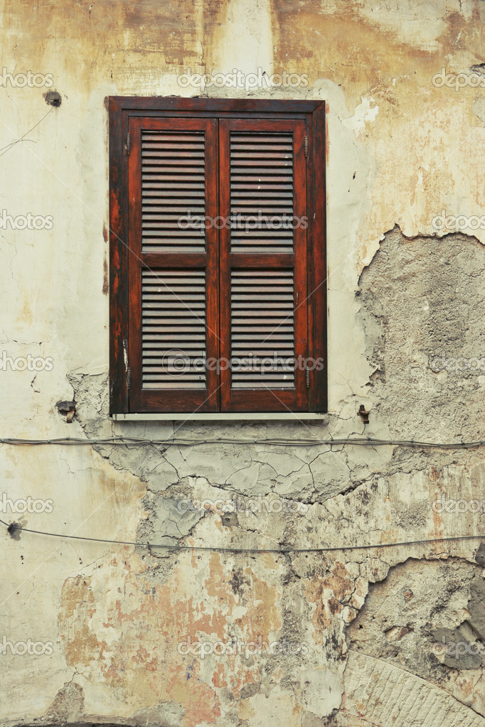 Old  shuttered window on the dilapidated building — Stock Photo #10230992