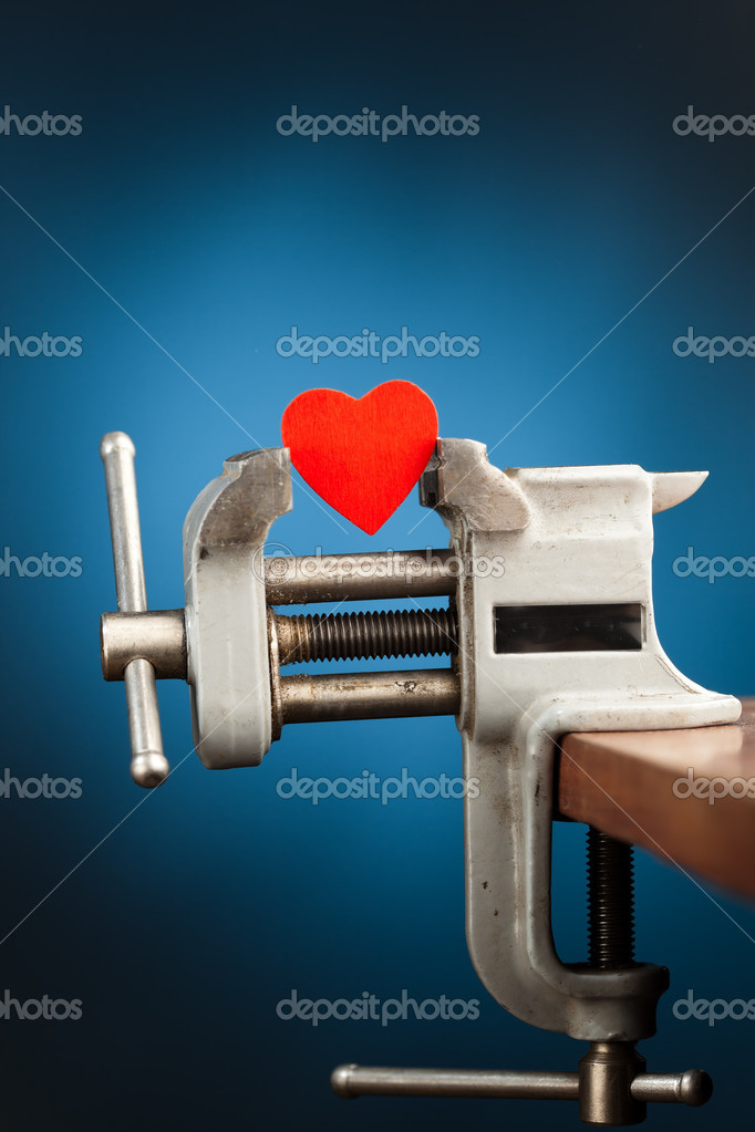 Red heart in the vice tool — Stock Photo #10231829