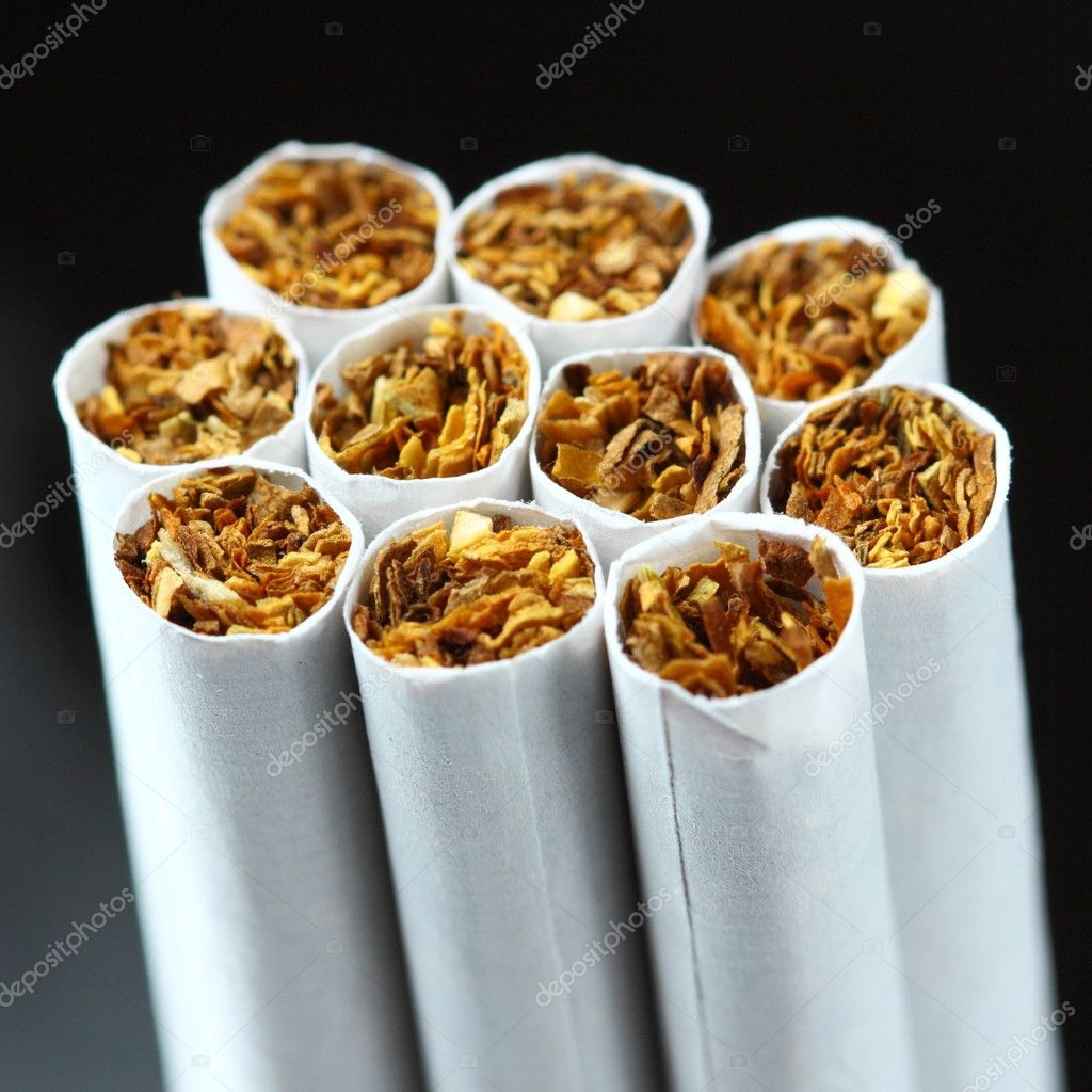 Cigarettes on black — Stock Photo #10232940