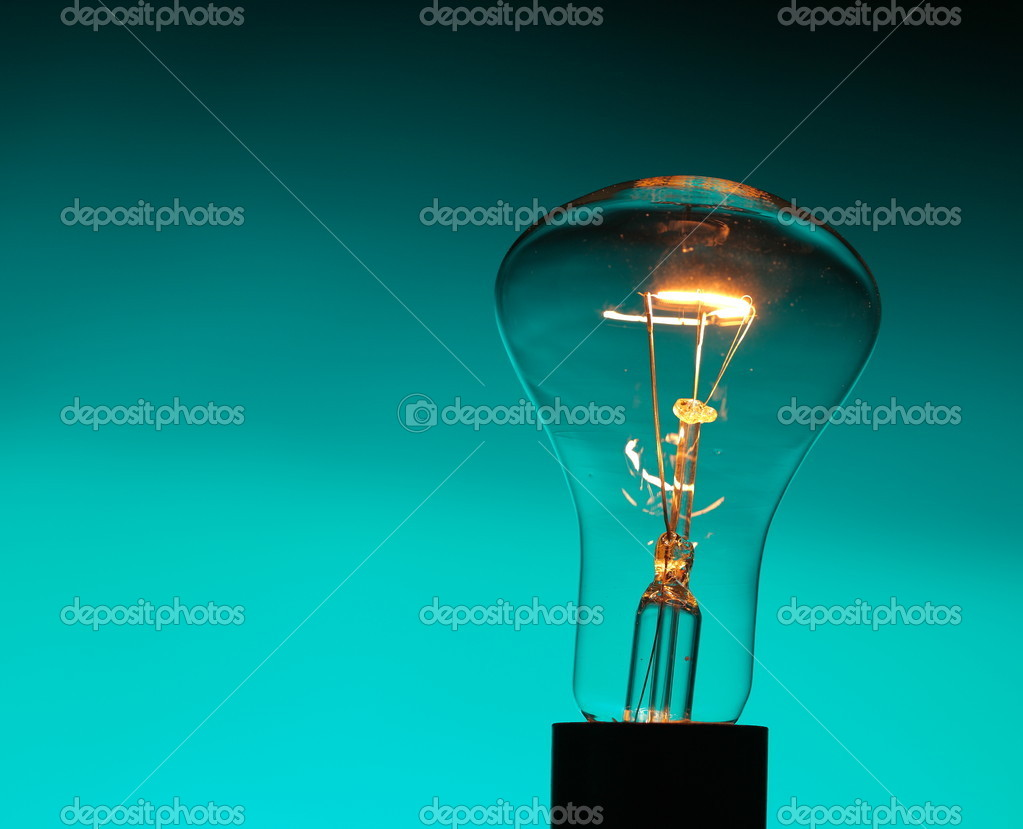 Light bulb on blue  Stock Photo #10236007