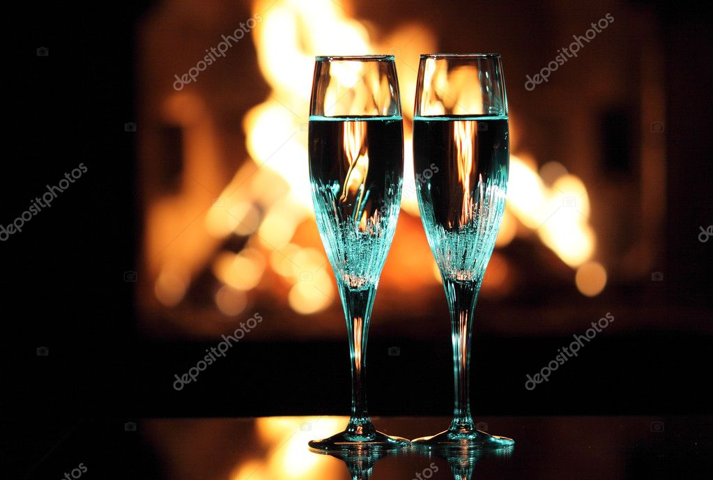 Blue glasses in front of fireplace — Stock Photo #10236679