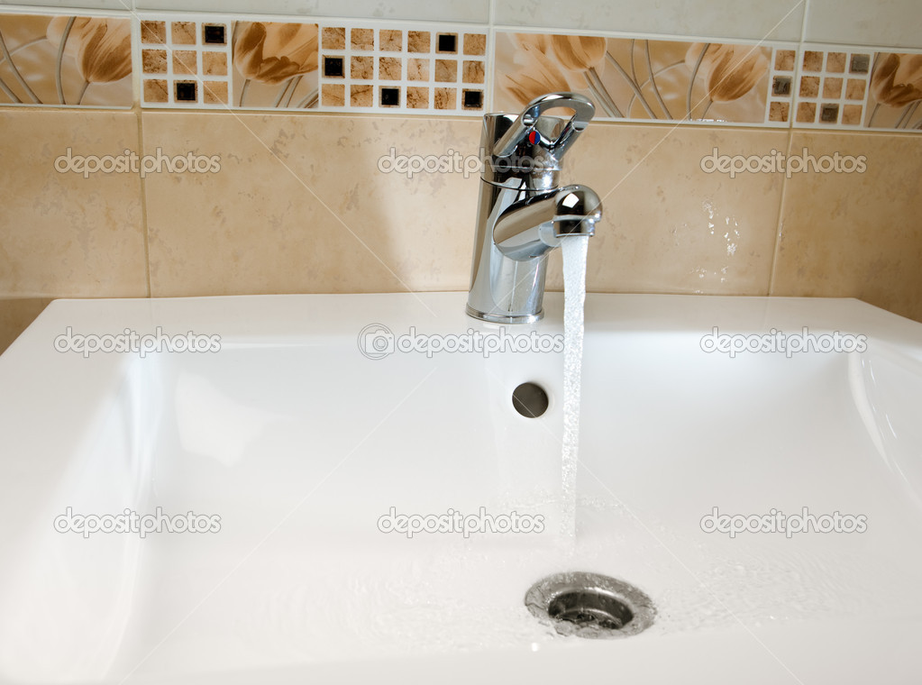 Mixer tap in use — Stock Photo #10239477