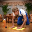 Professional cleaner washes the floor — Stock Photo