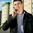 Real estate agent on mobile phone — Stock Photo #10241100
