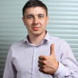 Thumb's up by a young manager - Foto Stock