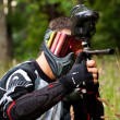 Paintball shooter in the field — Stock Photo