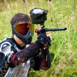 Paintball shooter aiming the gun — Stock Photo