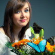 Beautiful girl and flowers — Stock Photo