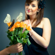 Beautiful girl get a flower bouquet — Stock Photo
