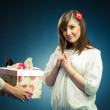 Beautiful girl receives a gift — Stock Photo